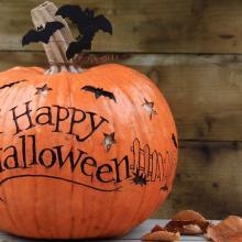 Pumpkin that says Happy Halloween